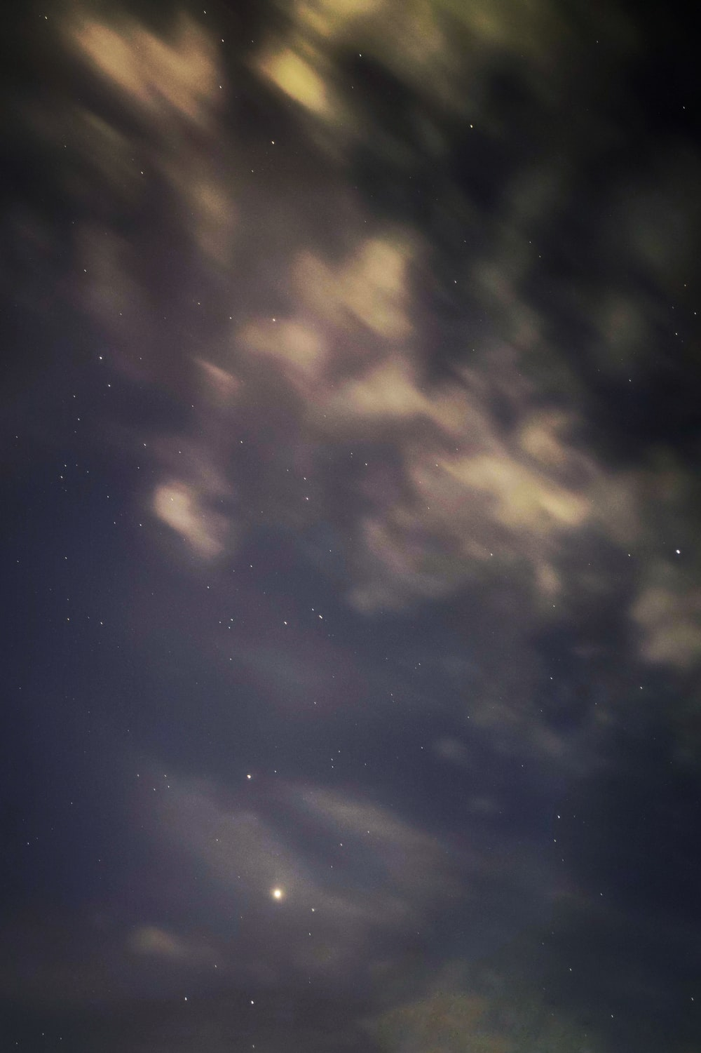 white clouds and blue sky during night time