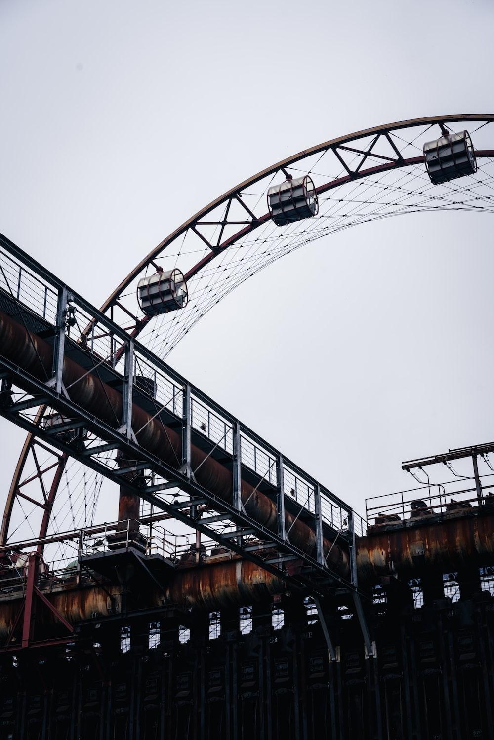 brown and black metal bridge under white sky during daytime