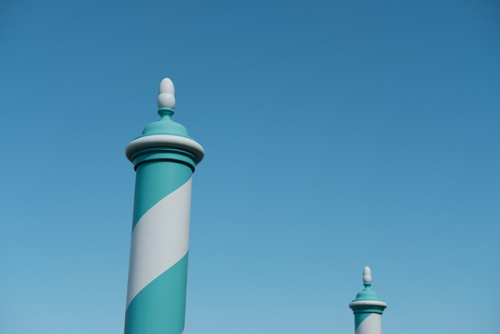 white and blue striped tower under blue sky during daytime