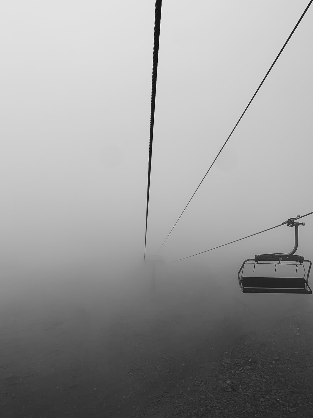black cable car on gray scale