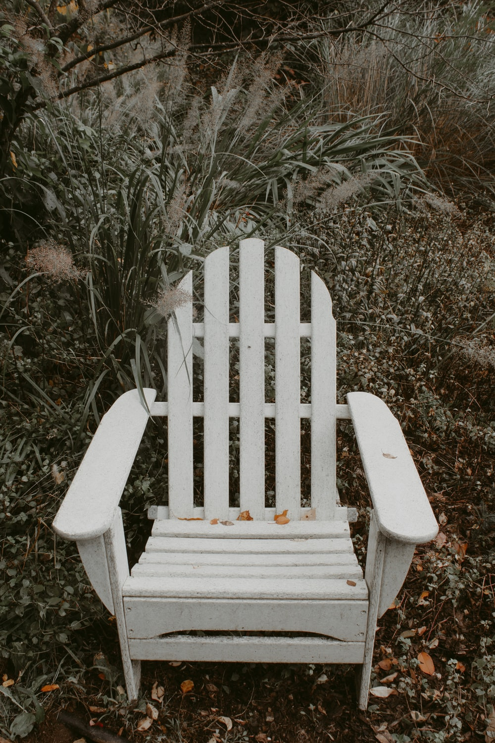 white wooden armchair on black and white photography