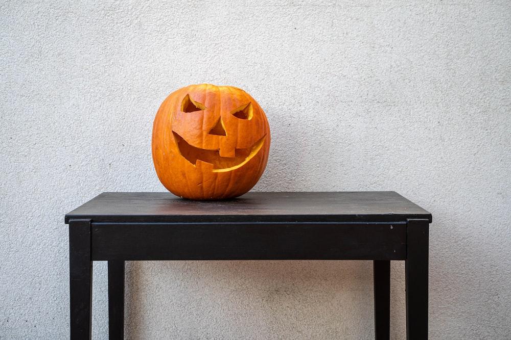 jack o lantern on black wooden table