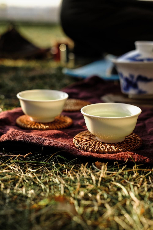 white ceramic bowl on brown woven basket