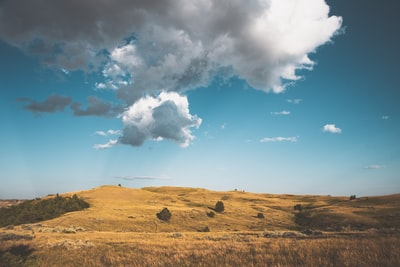 brown grass field under blue sky and white clouds during daytime north dakota zoom background