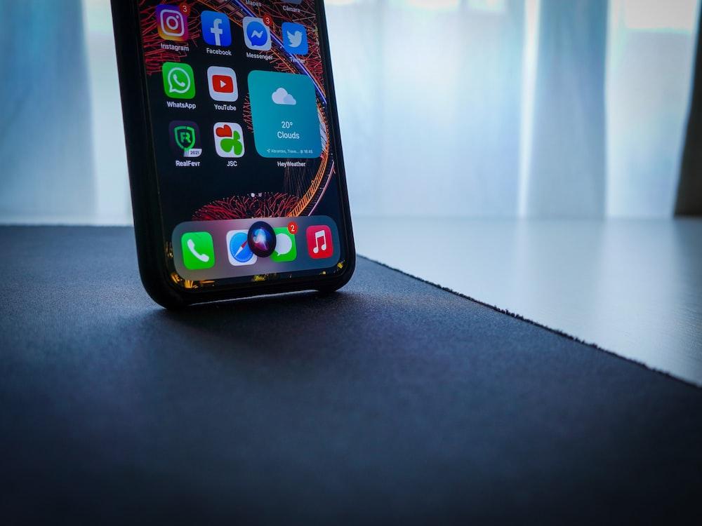 black iphone 5 on black table