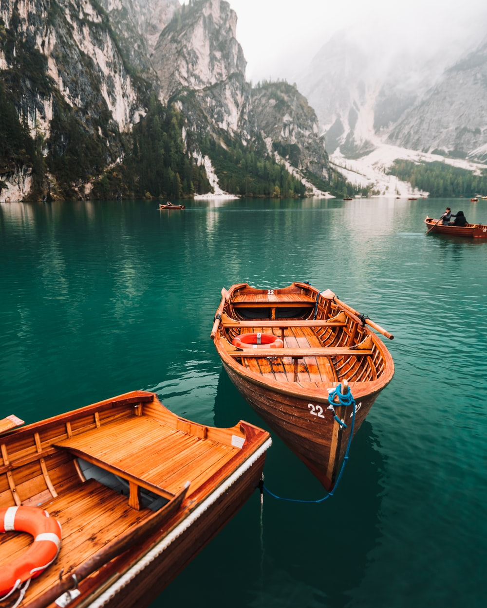 brown wooden boat on water