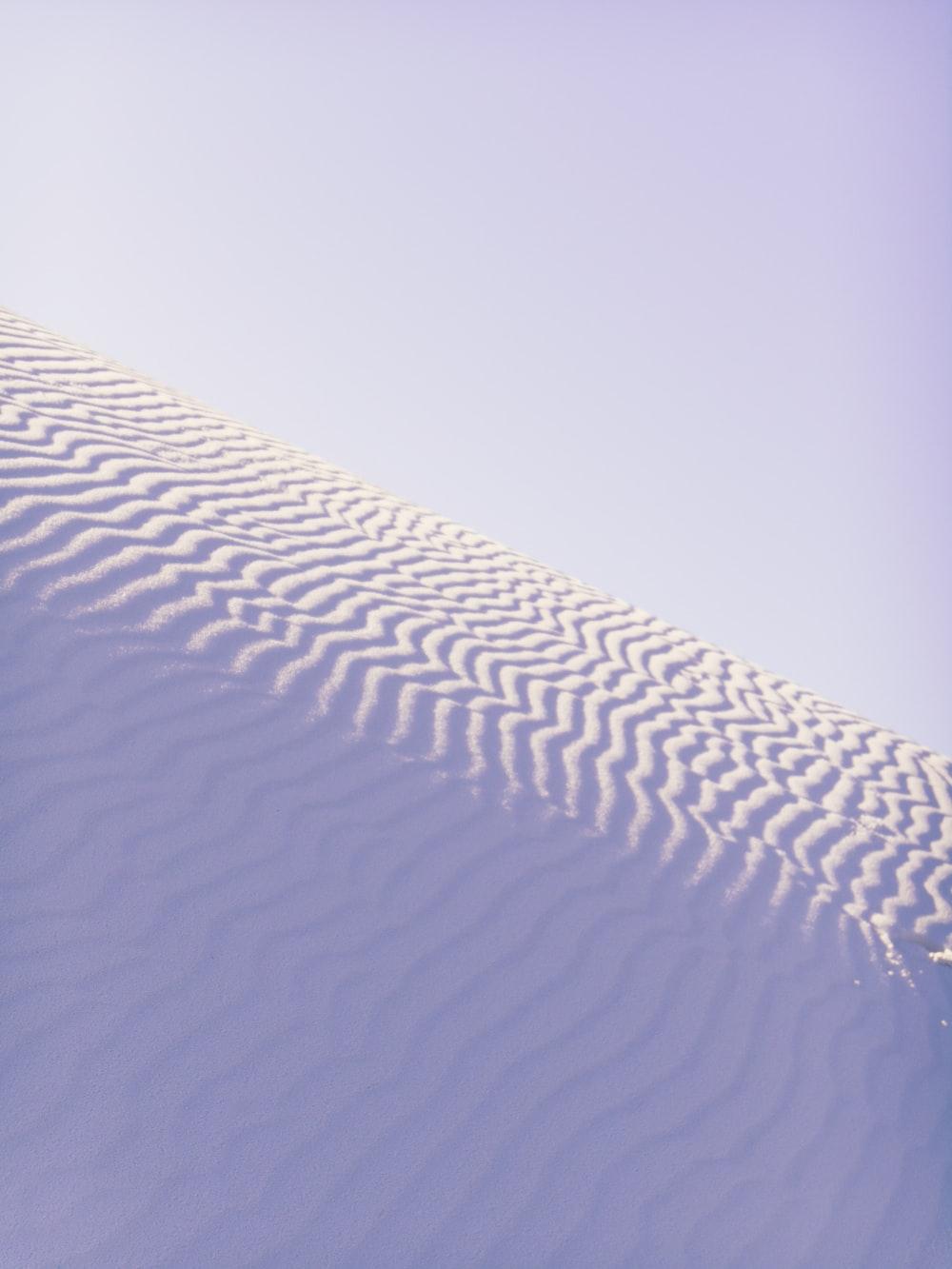 white sand under sunny sky