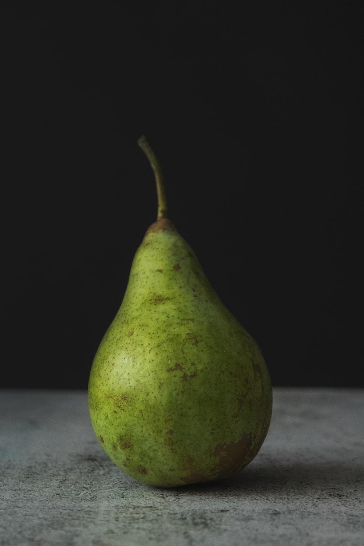 green fruit on white table