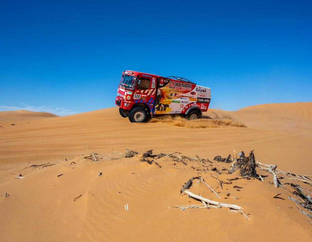 red truck on desert during daytime