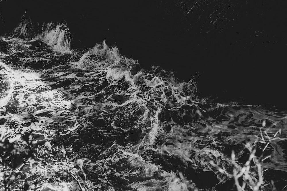 grayscale photo of water splash