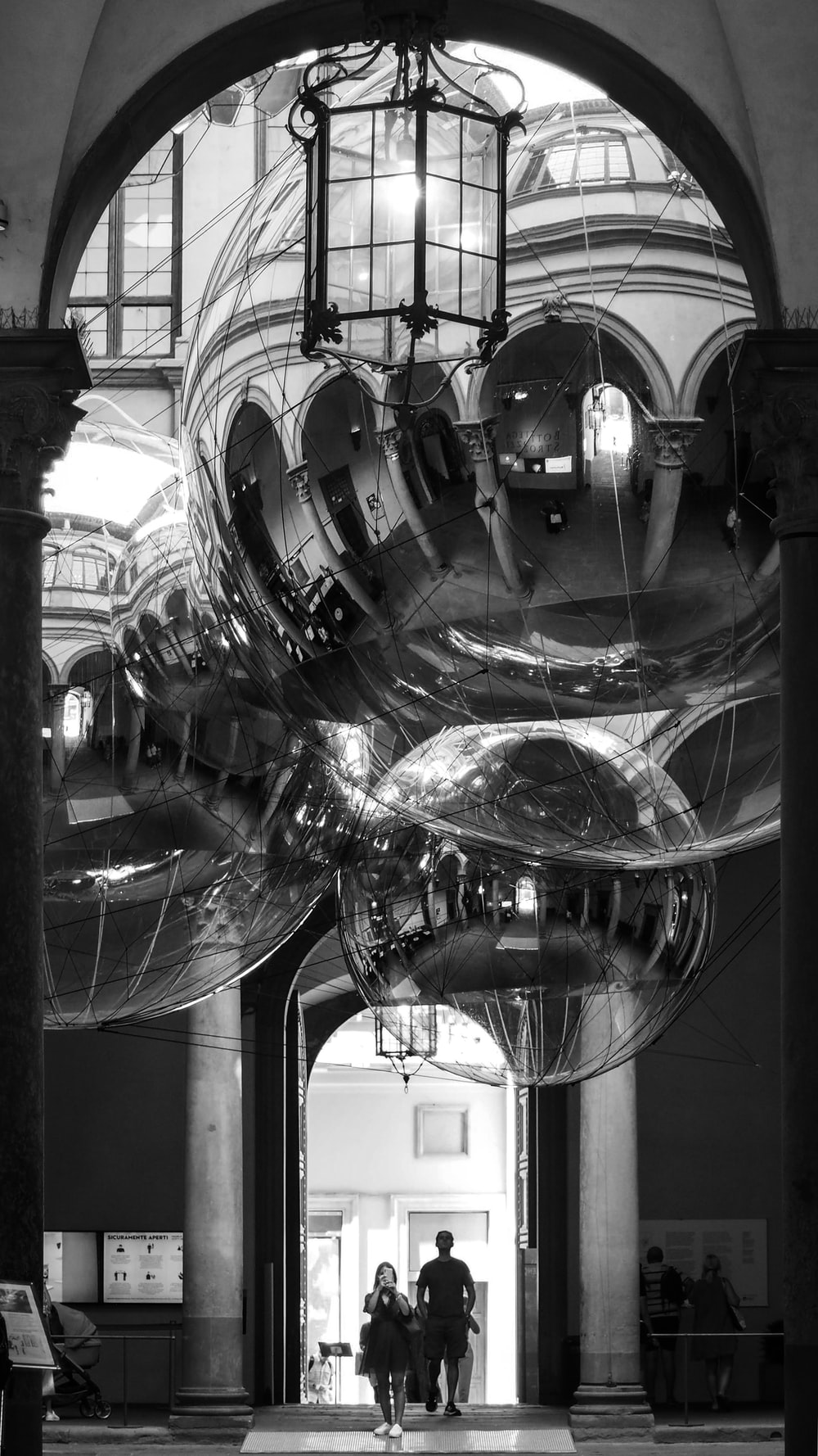grayscale photo of clear glass ball