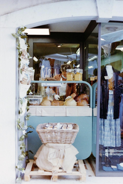 white wicker basket on blue wooden shelf