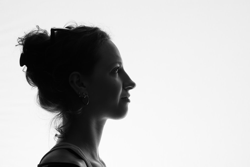 grayscale photo of woman in tank top