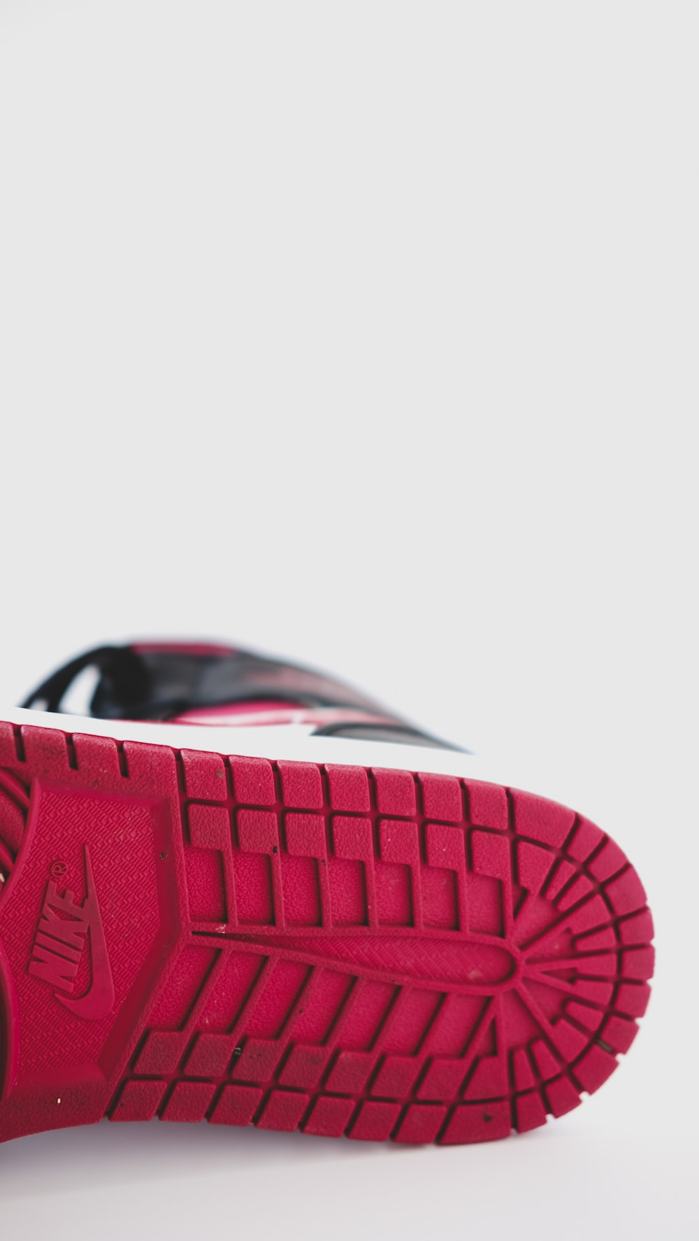 red and black nike athletic shoe