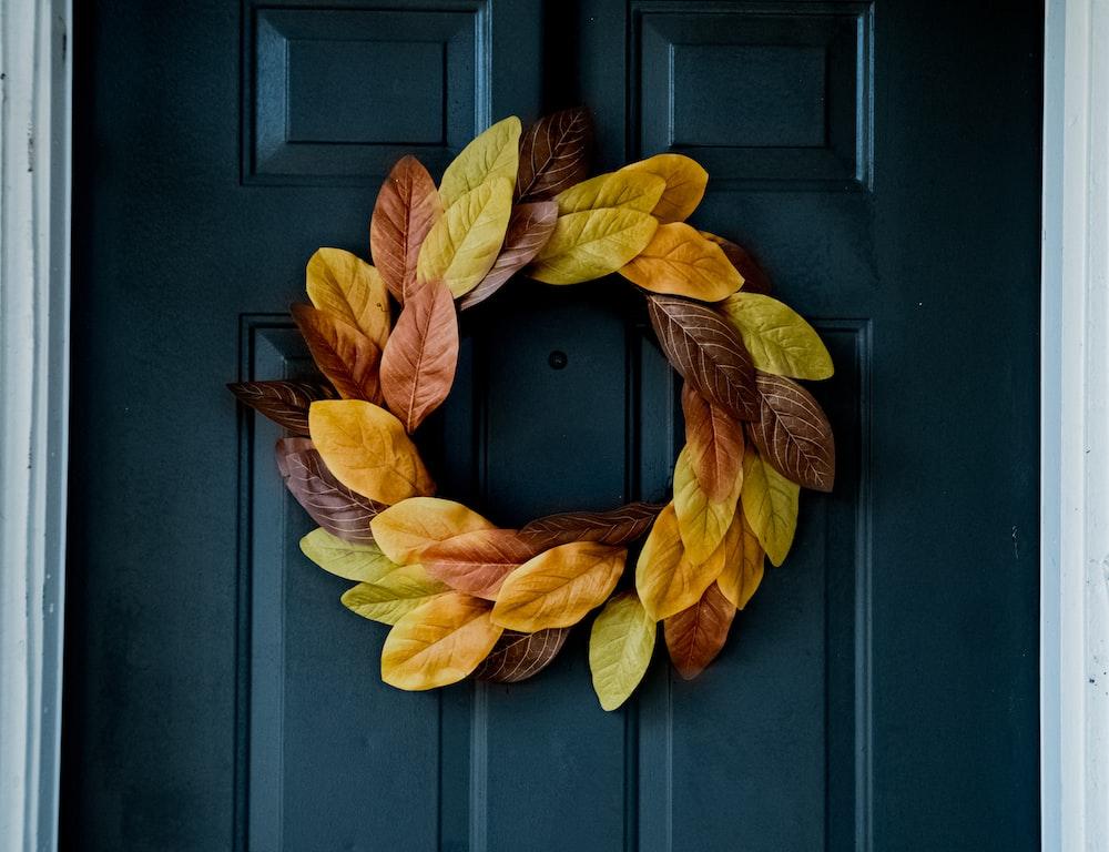 yellow leaves on blue wooden door