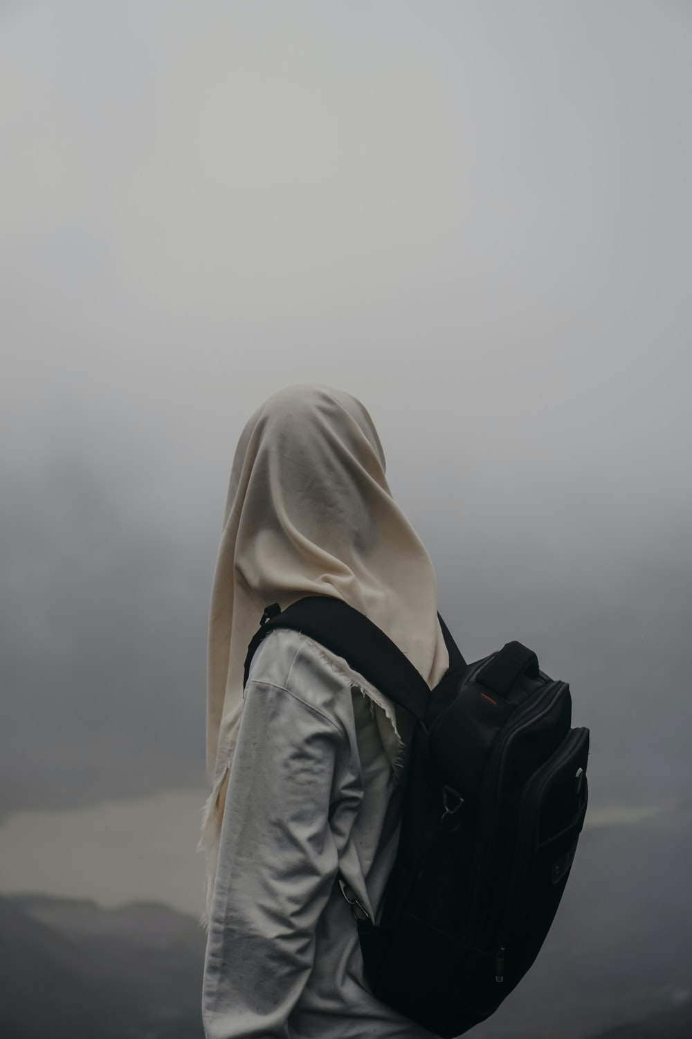 person in white hijab and black leather jacket