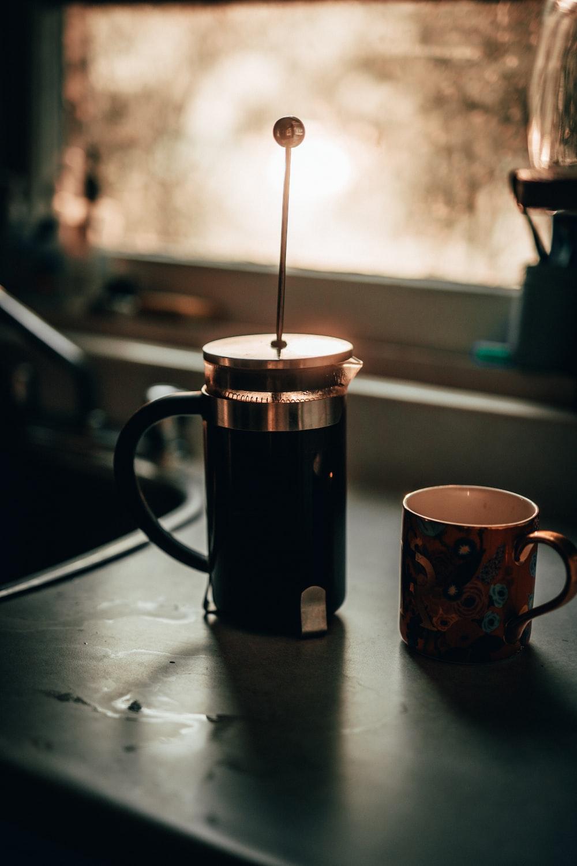 black and white ceramic mug on white table