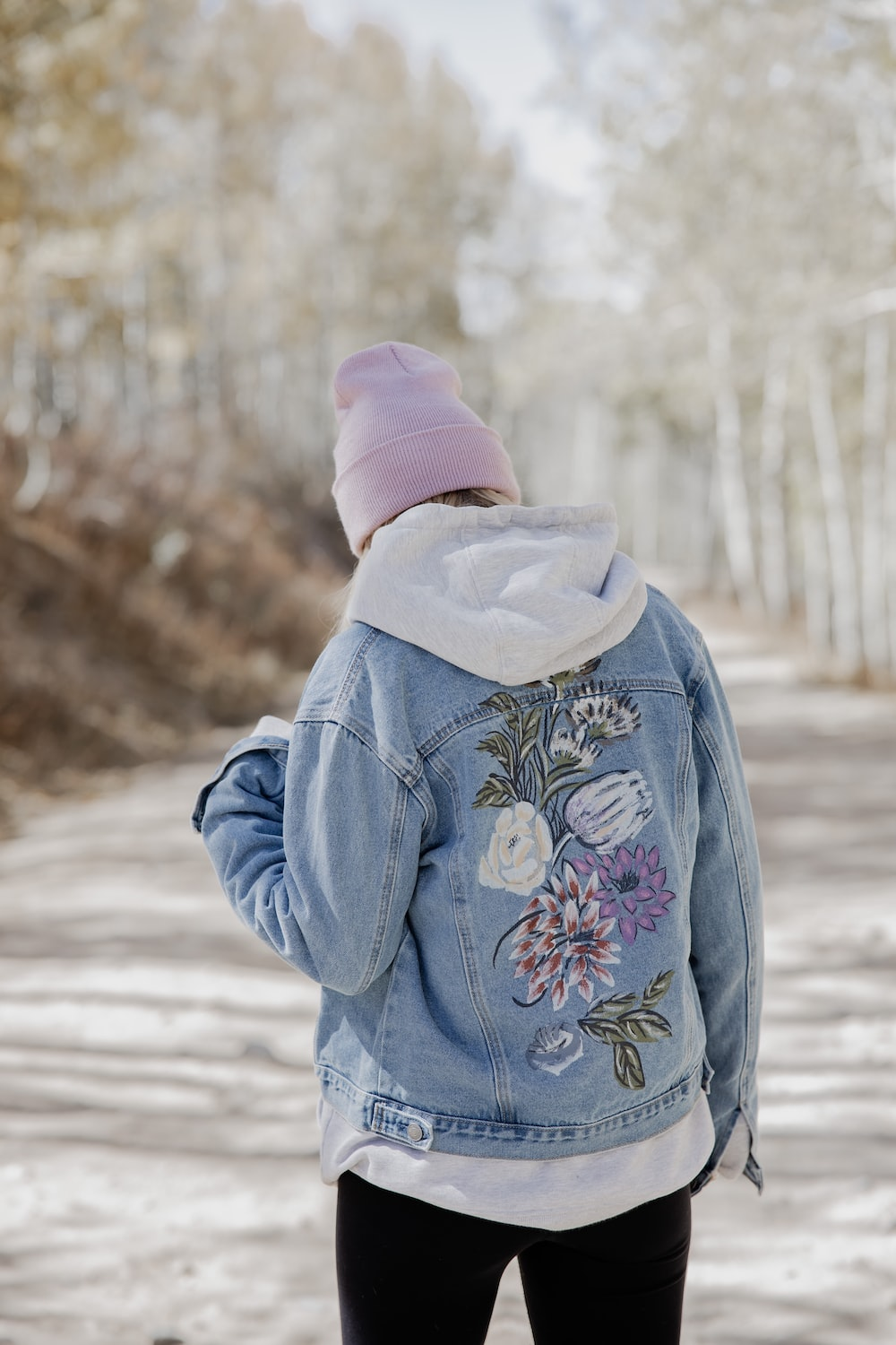 person in blue jacket and pink knit cap