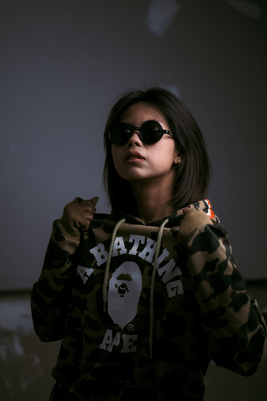 woman in black and white hoodie wearing black sunglasses