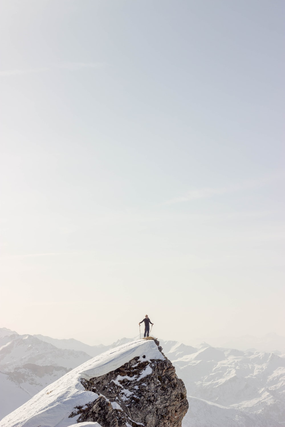 person standing on top of mountain during daytime