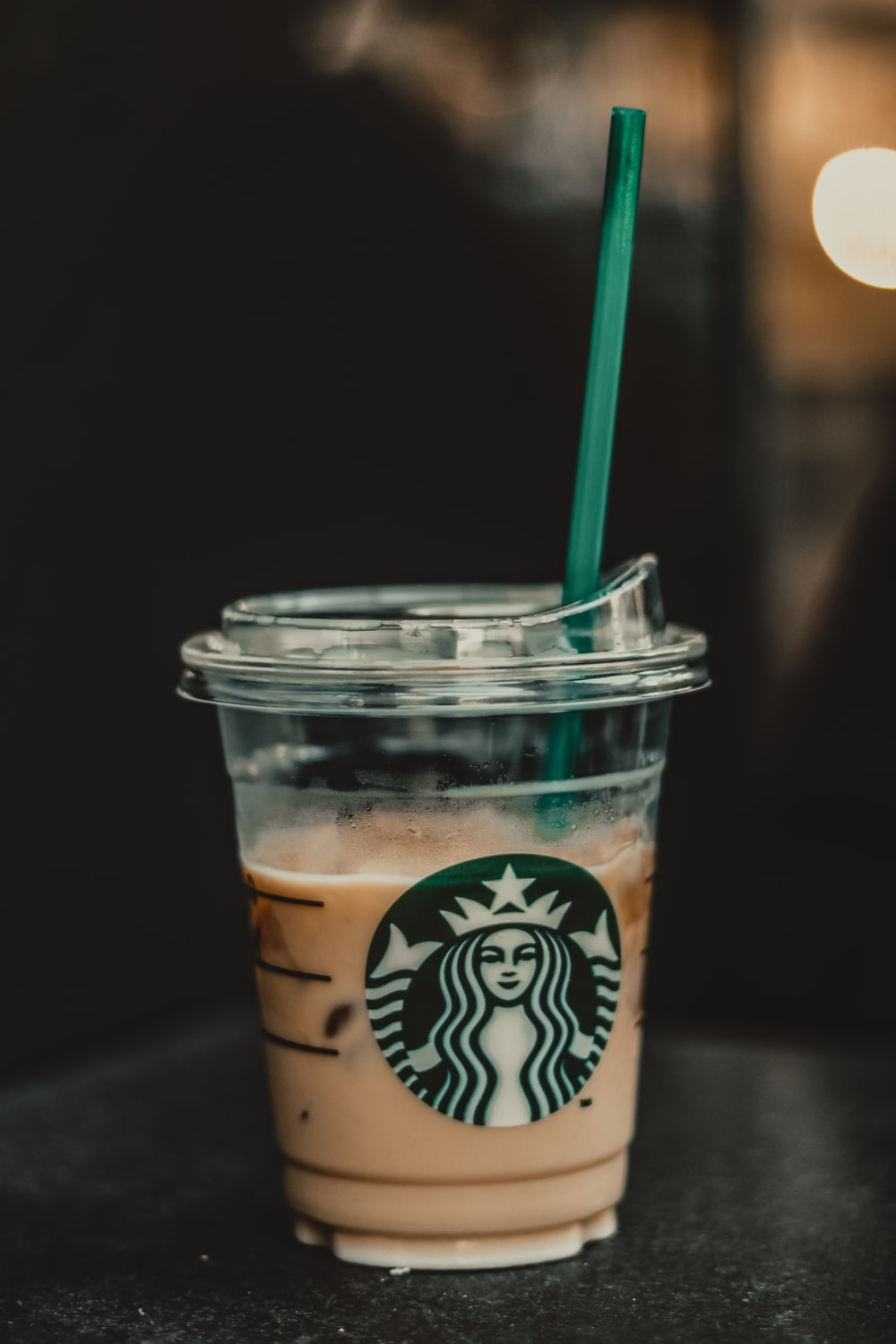 starbucks coffee cup with green straw
