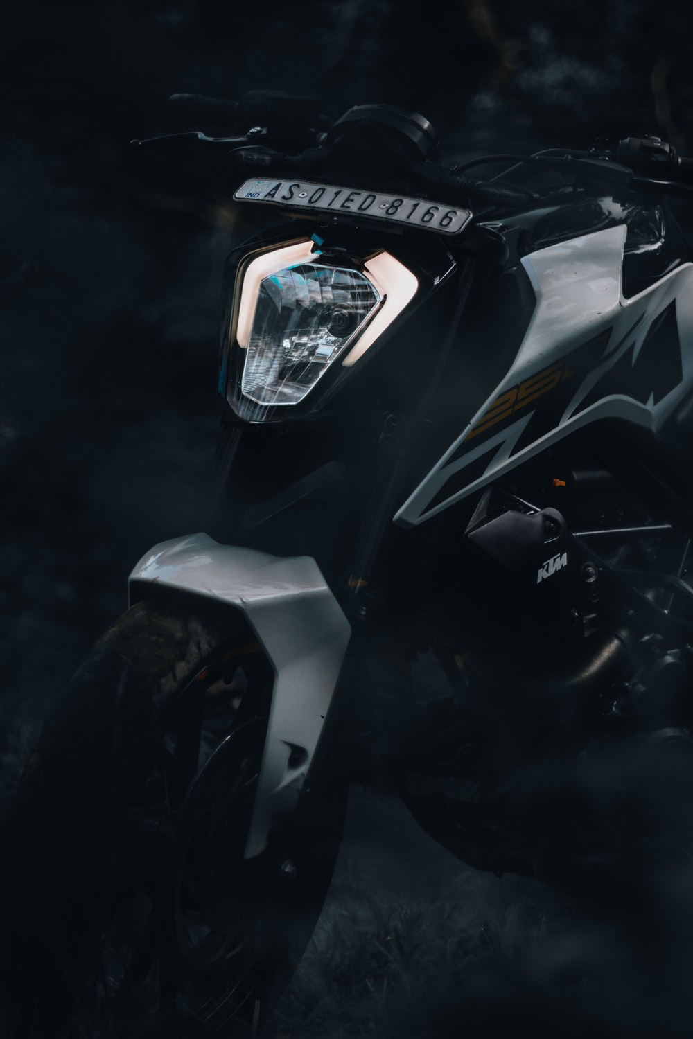 black and gray motorcycle with black and white helmet
