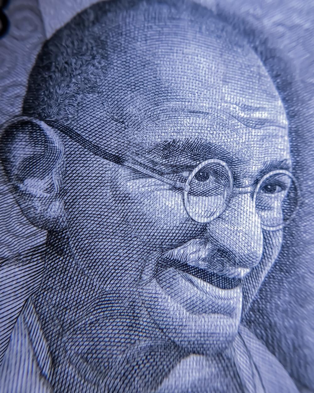 man in black and white plaid shirt wearing eyeglasses