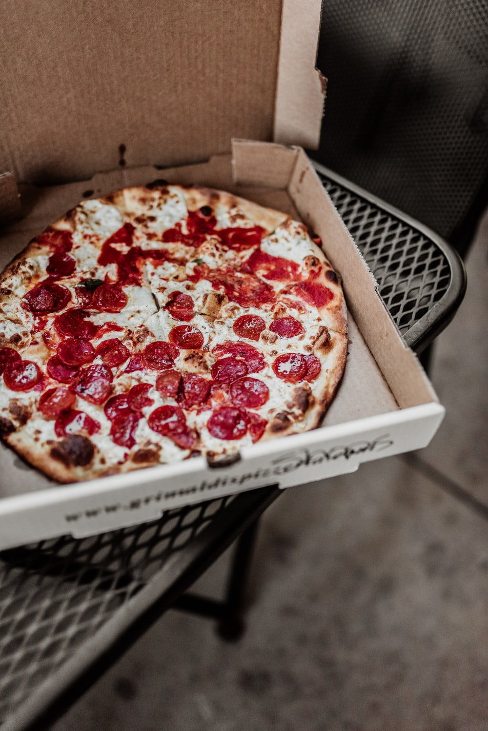 pizza on brown wooden box