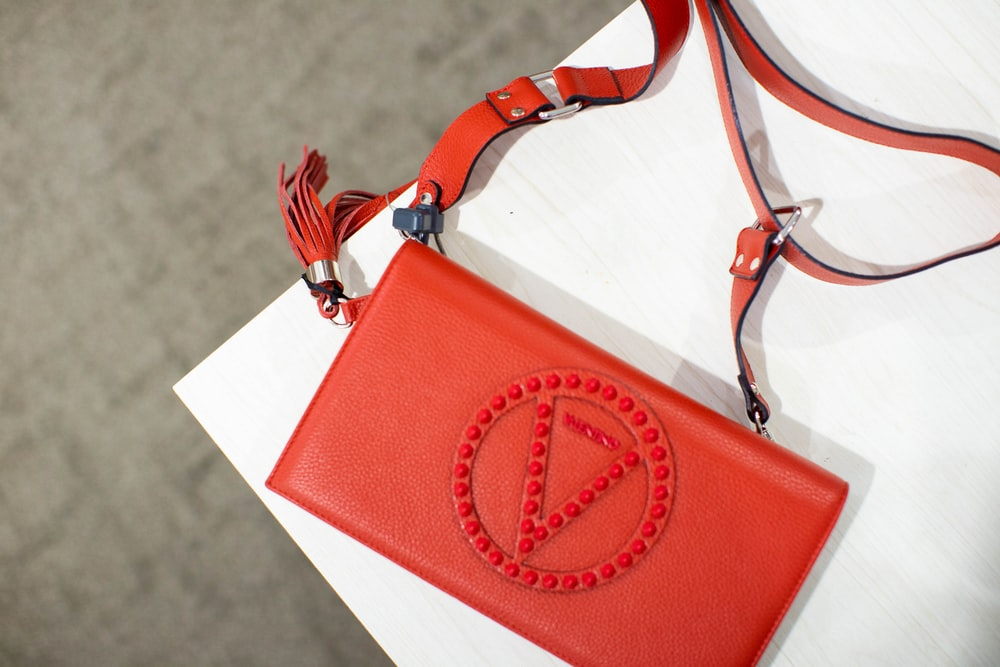 red and white sling bag