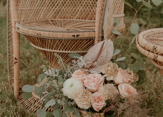white and pink flowers on brown wicker armchair