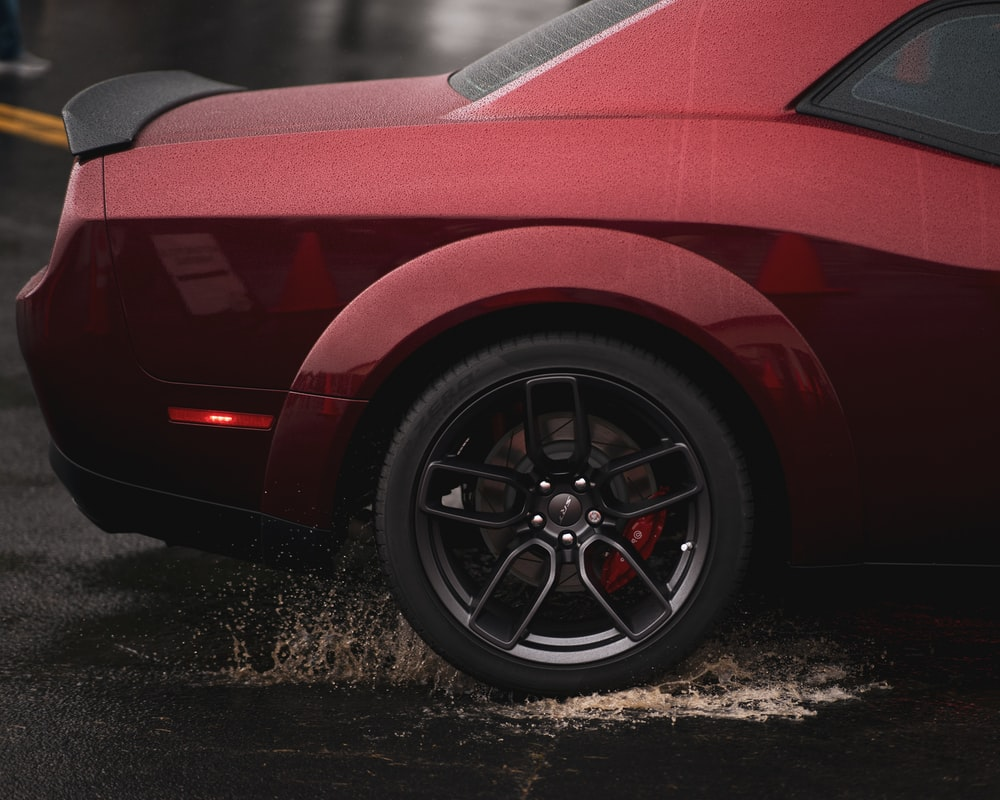 red car on black asphalt road
