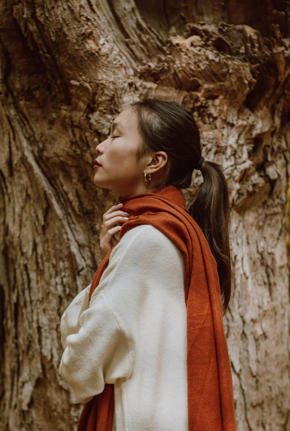 woman in white and red scarf