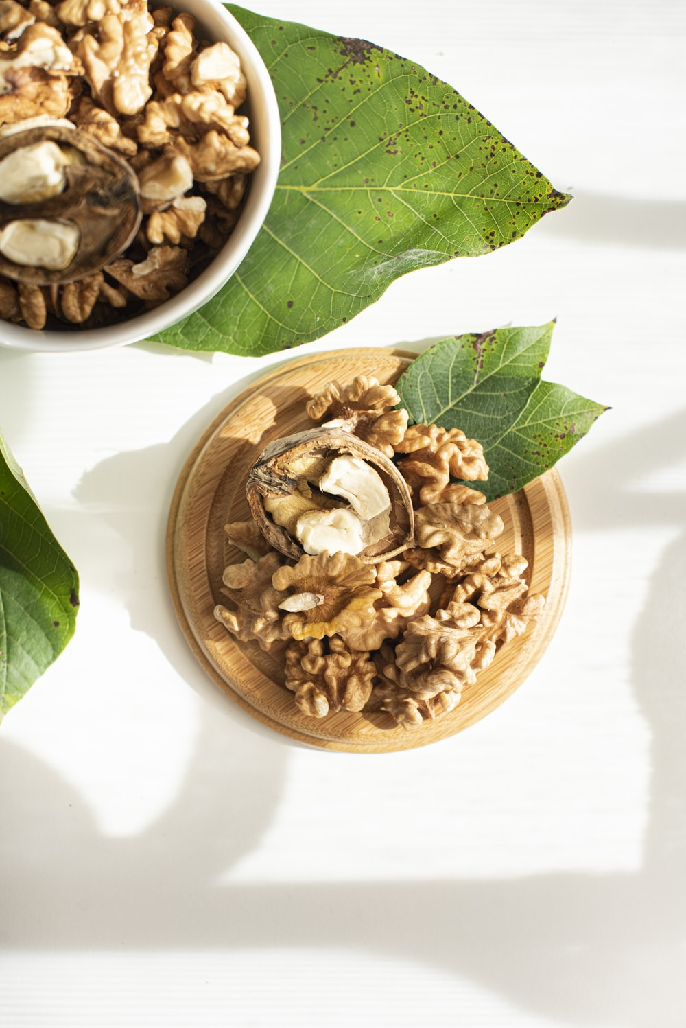 brown wooden bowl with brown nuts