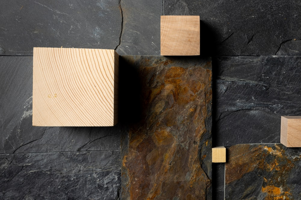 brown wooden chopping board on blue concrete wall