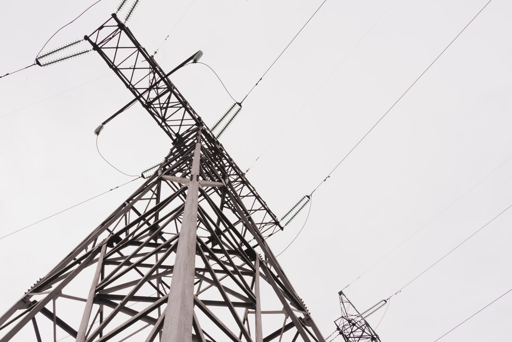 brown metal tower under white sky