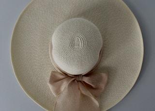 beige hat on white surface