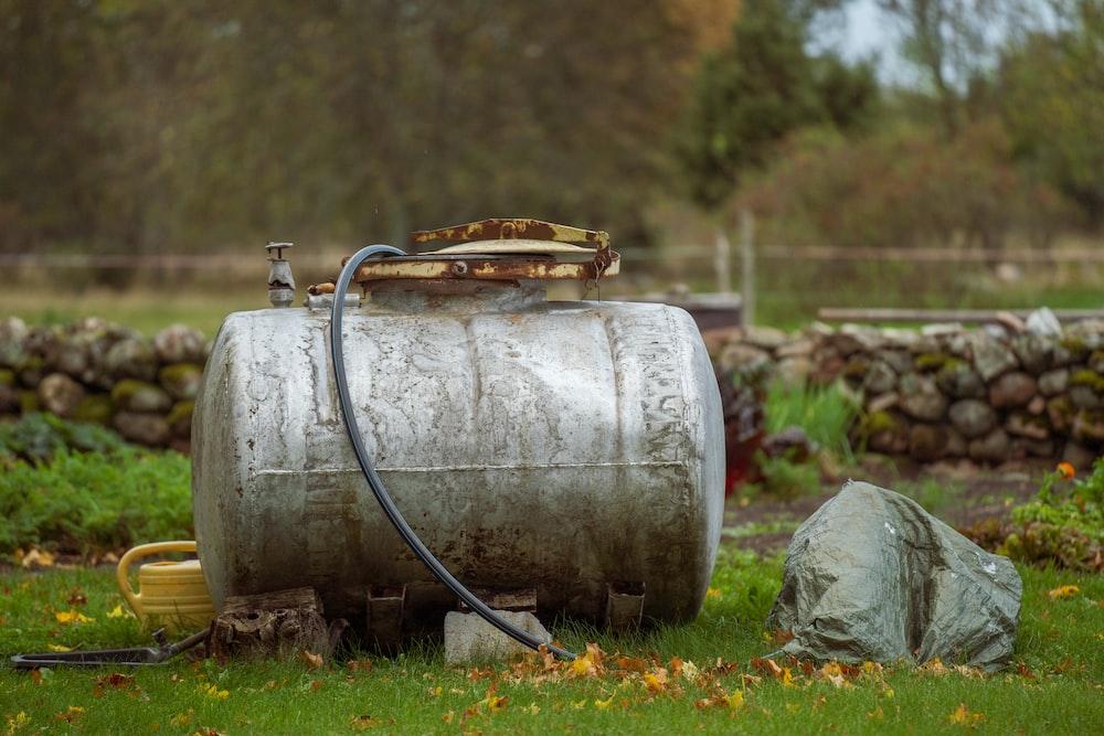 brown wooden barrel on green grass field
