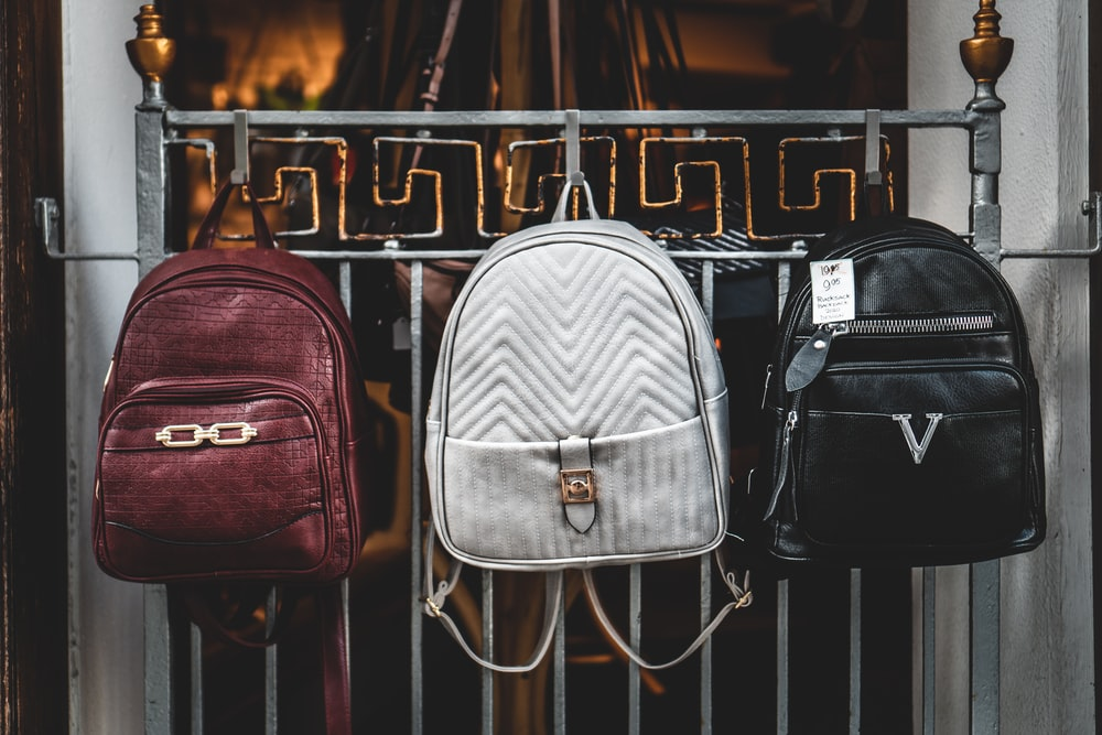 brown leather backpack on brown wooden table