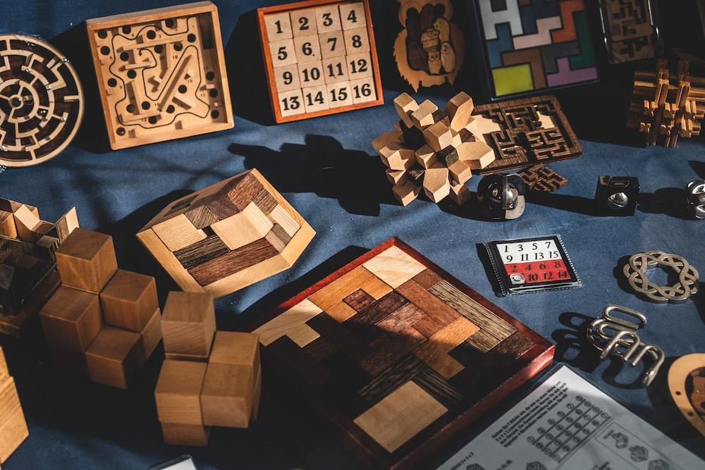 brown wooden blocks on blue textile