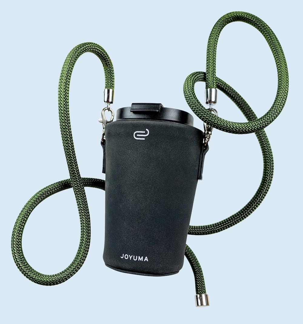 black and green nikon dslr camera bag