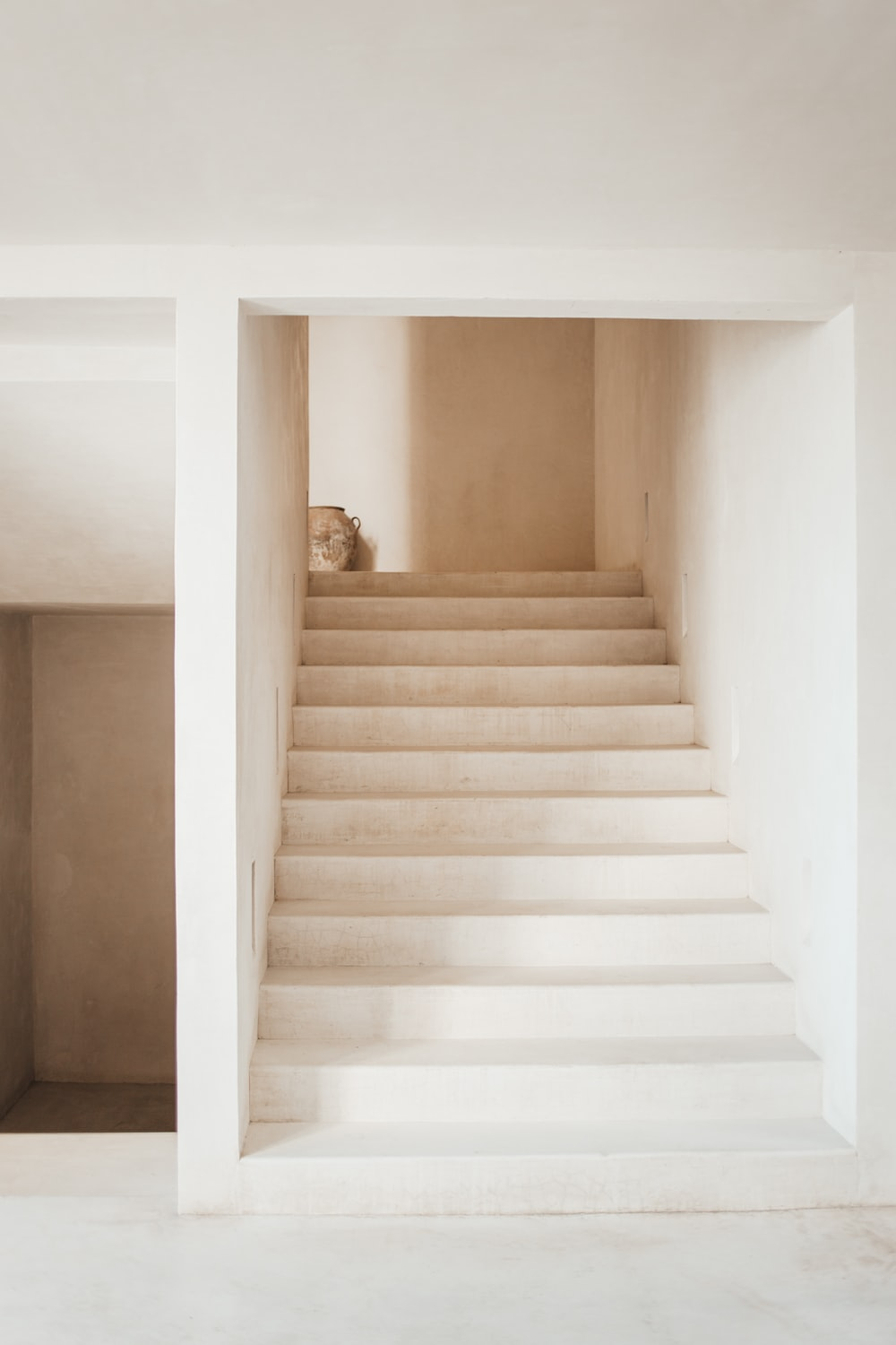 white wooden staircase with white wooden railings