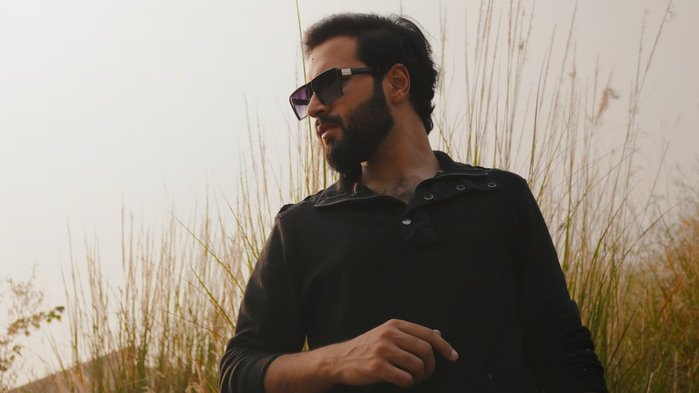 man in black dress shirt wearing black sunglasses