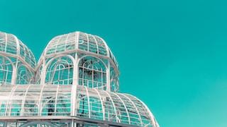 white metal frame glass building under blue sky during daytime