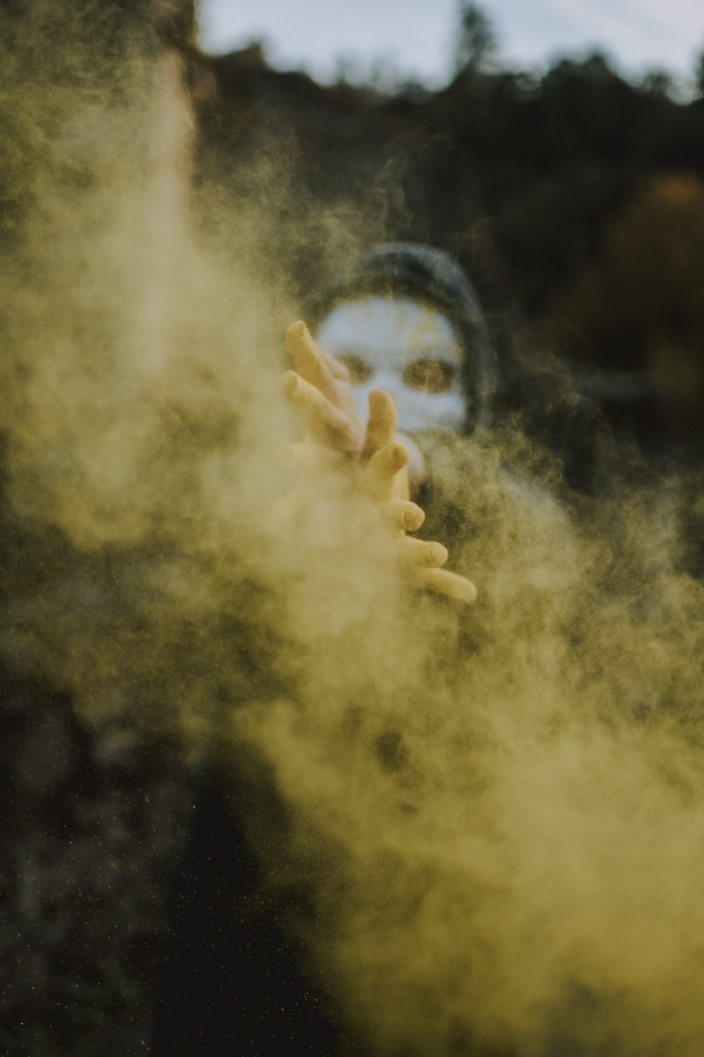 persons hand with smoke