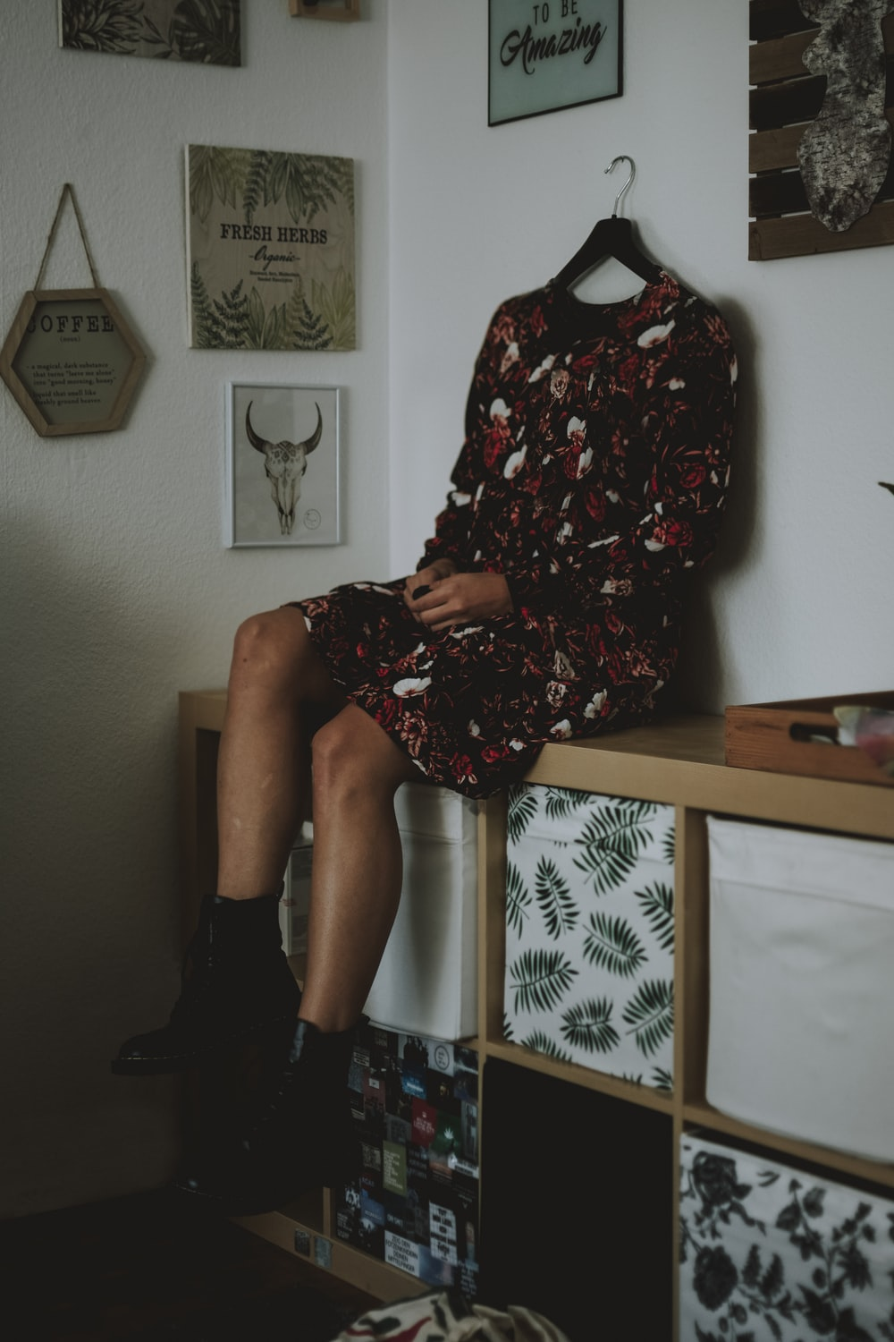 woman in black red and white floral dress sitting on chair