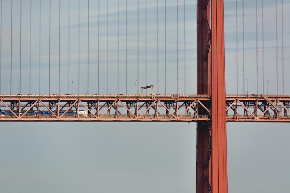 brown metal bridge under white sky during daytime