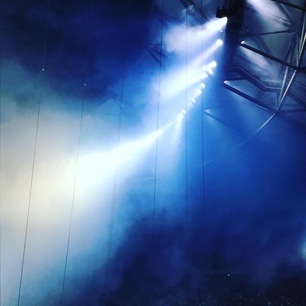 blue and white light on a dark sky