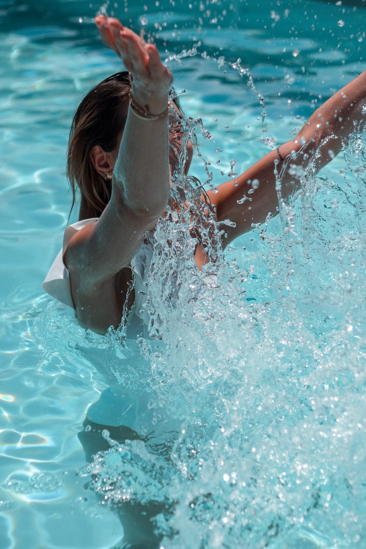 woman in white bikini top in water