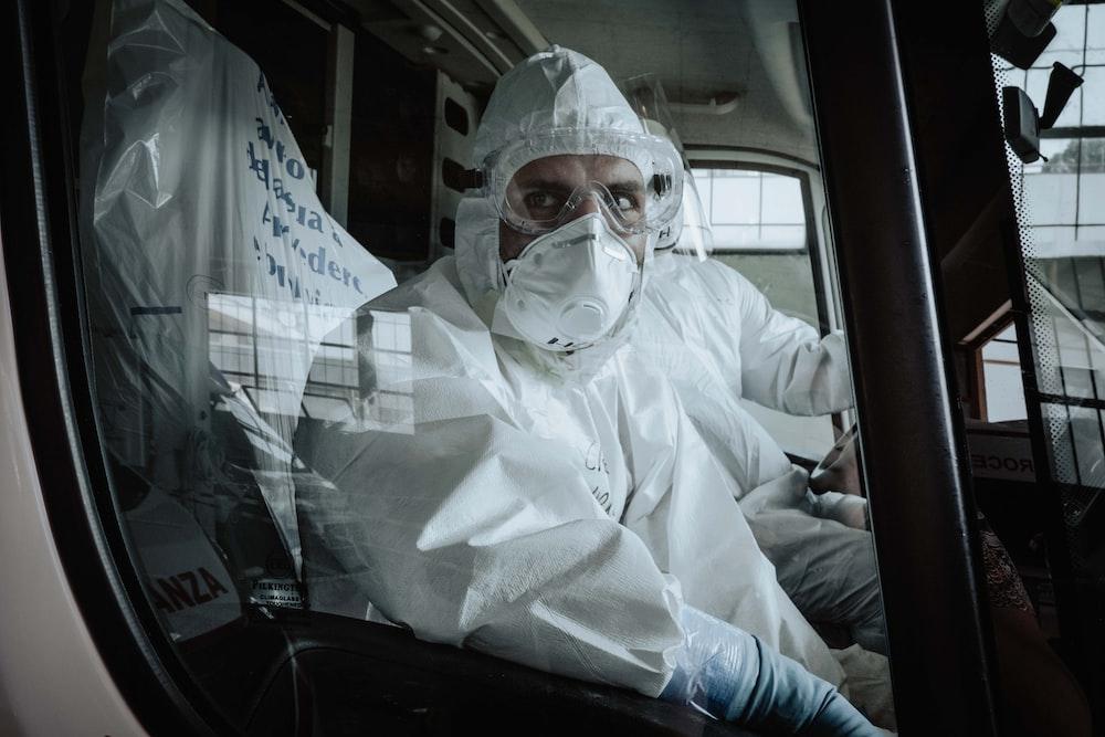 man in white dress shirt wearing white face mask