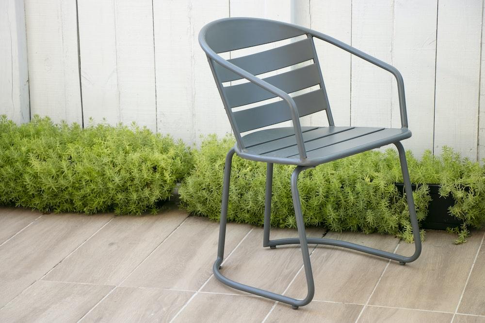 gray plastic armchair on green grass
